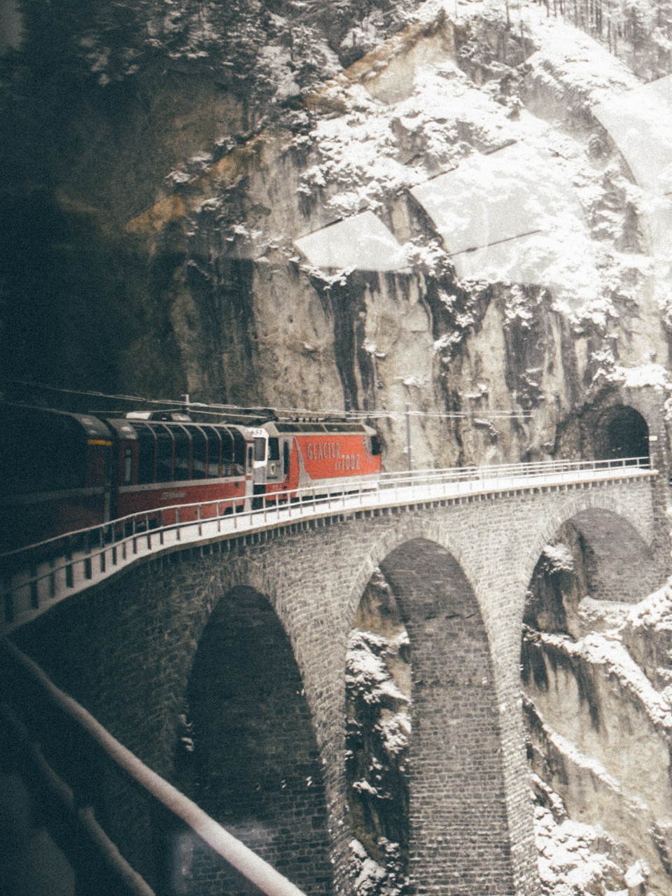 One of the 95 tunnels throughout the journey. title=Bernina Express entering tunnel.